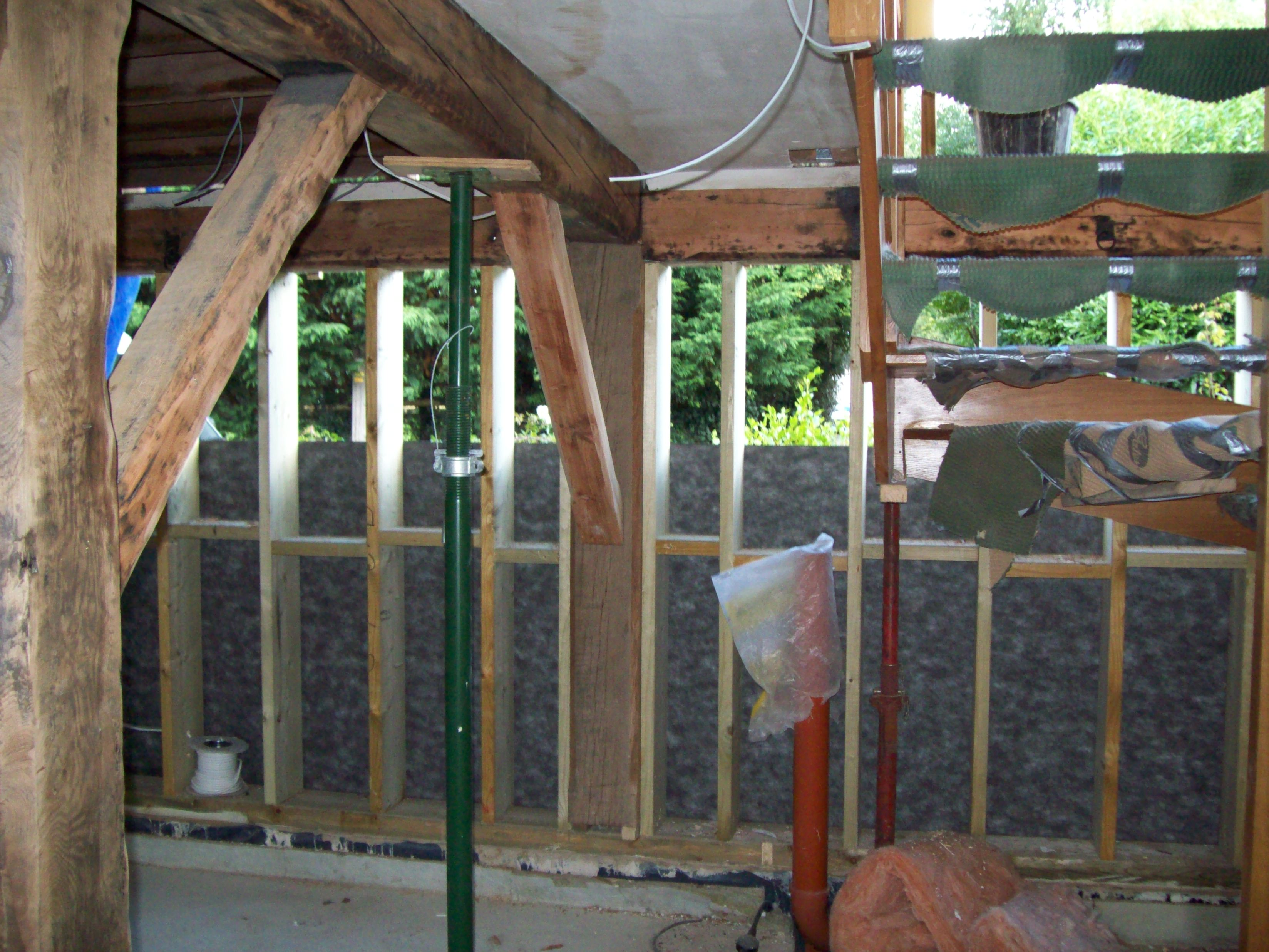 Stud frame with breathable membrane being installed