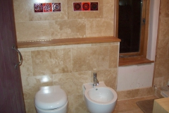 Polished travertine in en suite